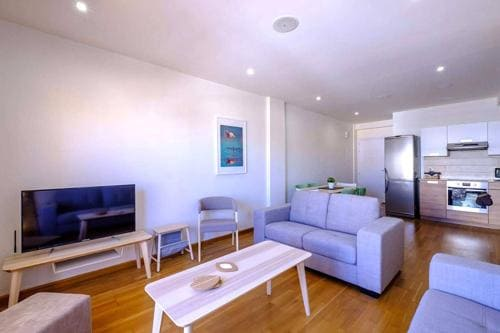 big blue sofa in a modern two bedroom apartment in Larnaca