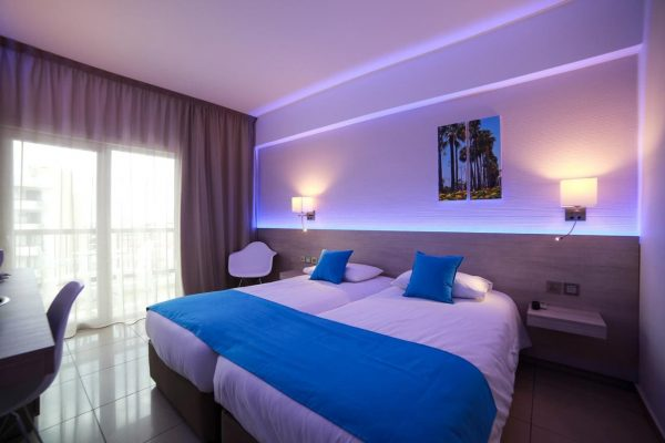 Two twin beds in a modern hotel room in Larnaca