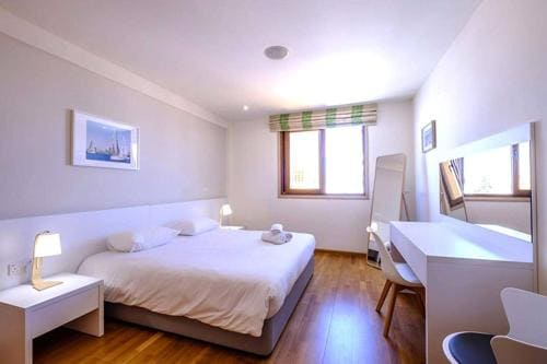 double bed in a luxury apartment in Larnaca